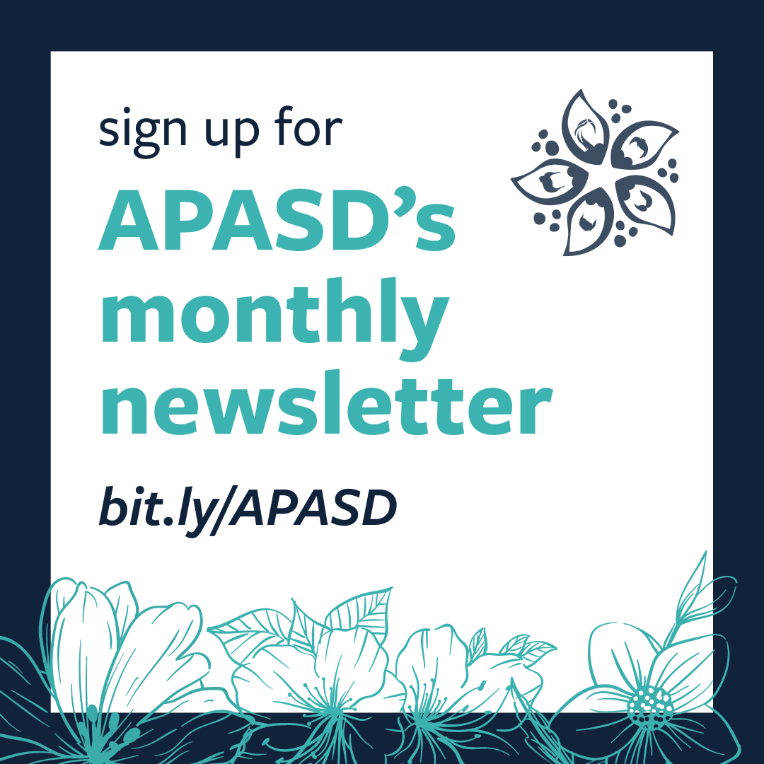 A navy blue background with a white box that read's sign up for APASD's monthly newsletter.